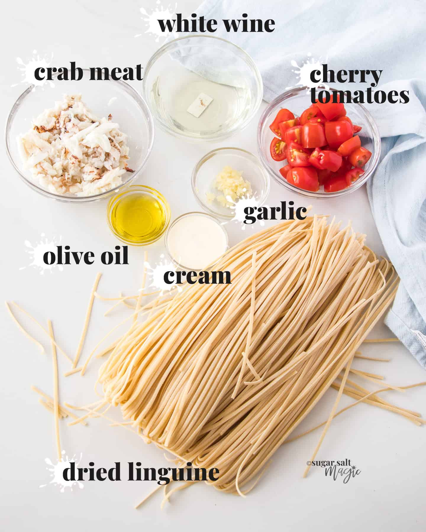 Ingredients for crab linguine on a benchtop.