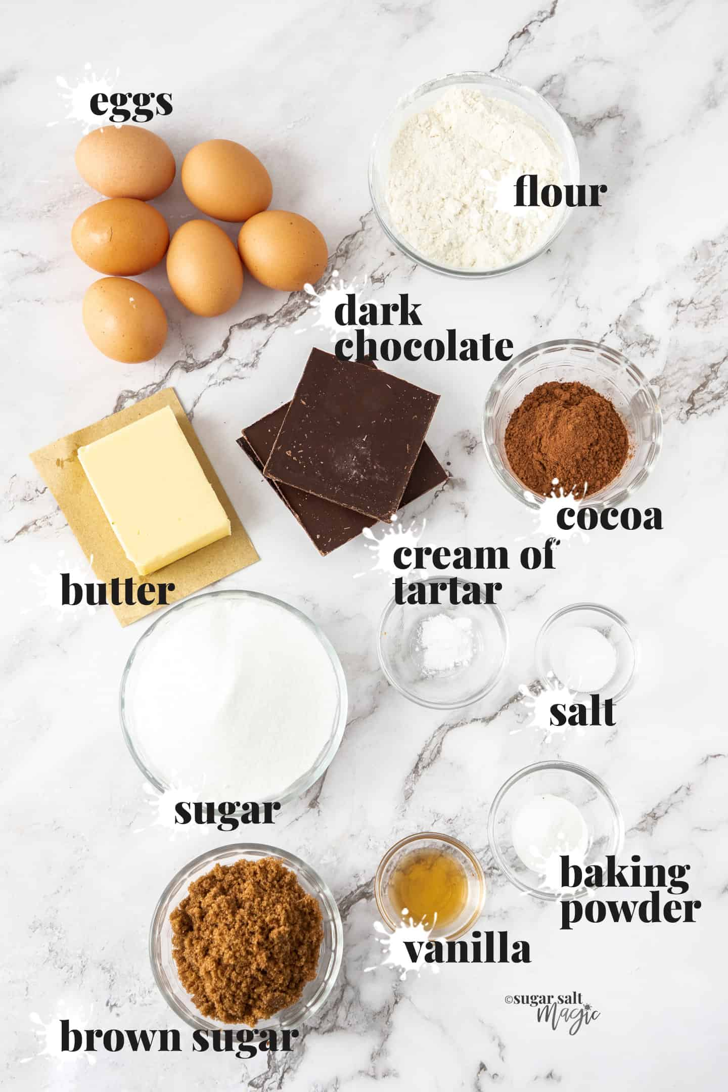 Ingredients for the cake on a marble surface.