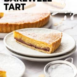 A slice of bakewell tart sitting on a white dessert plate.