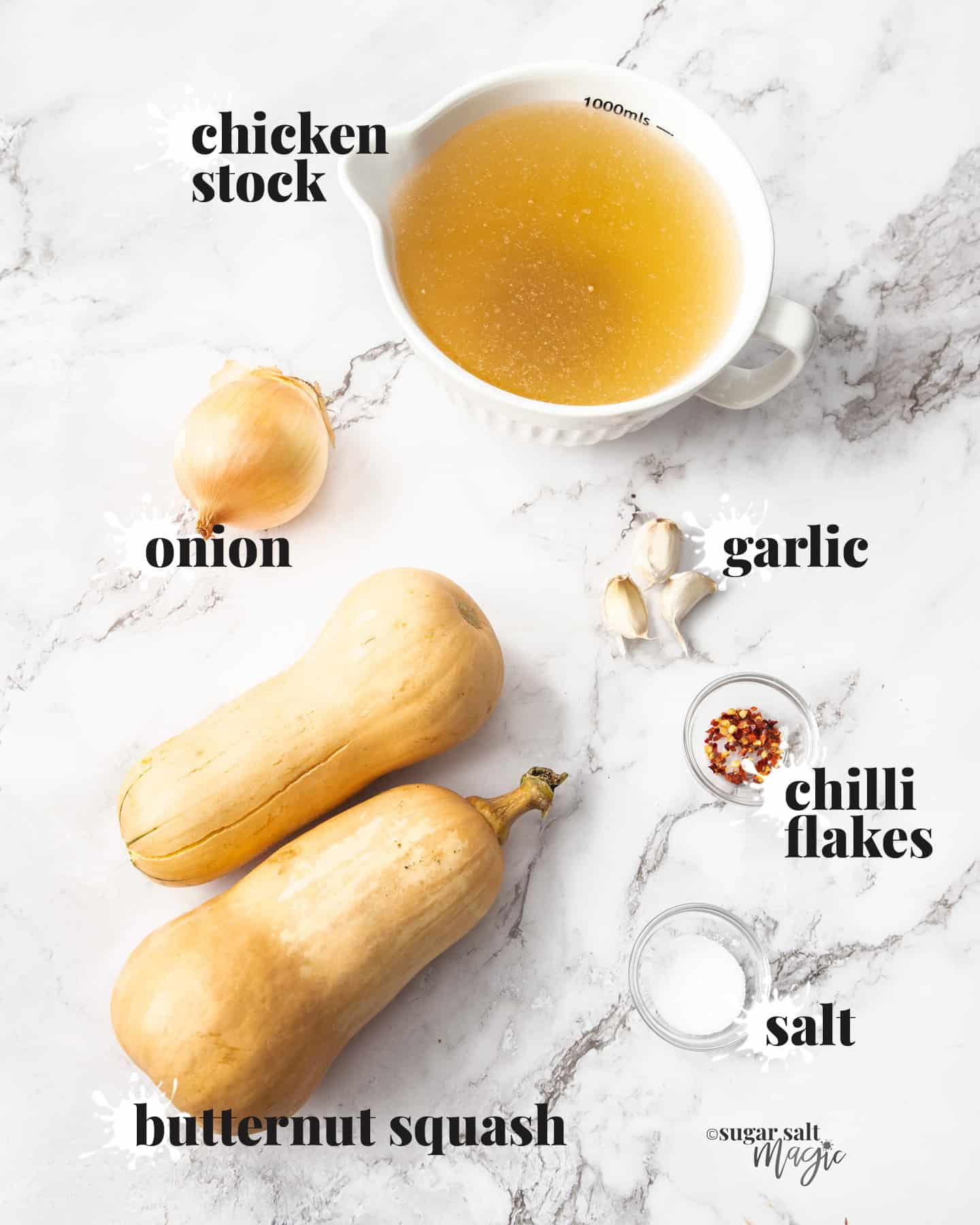 Ingredients for butternut squash soup on a marble benchtop.