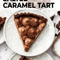 Top down view of a slice of chocolate caramel tart on a white plate.