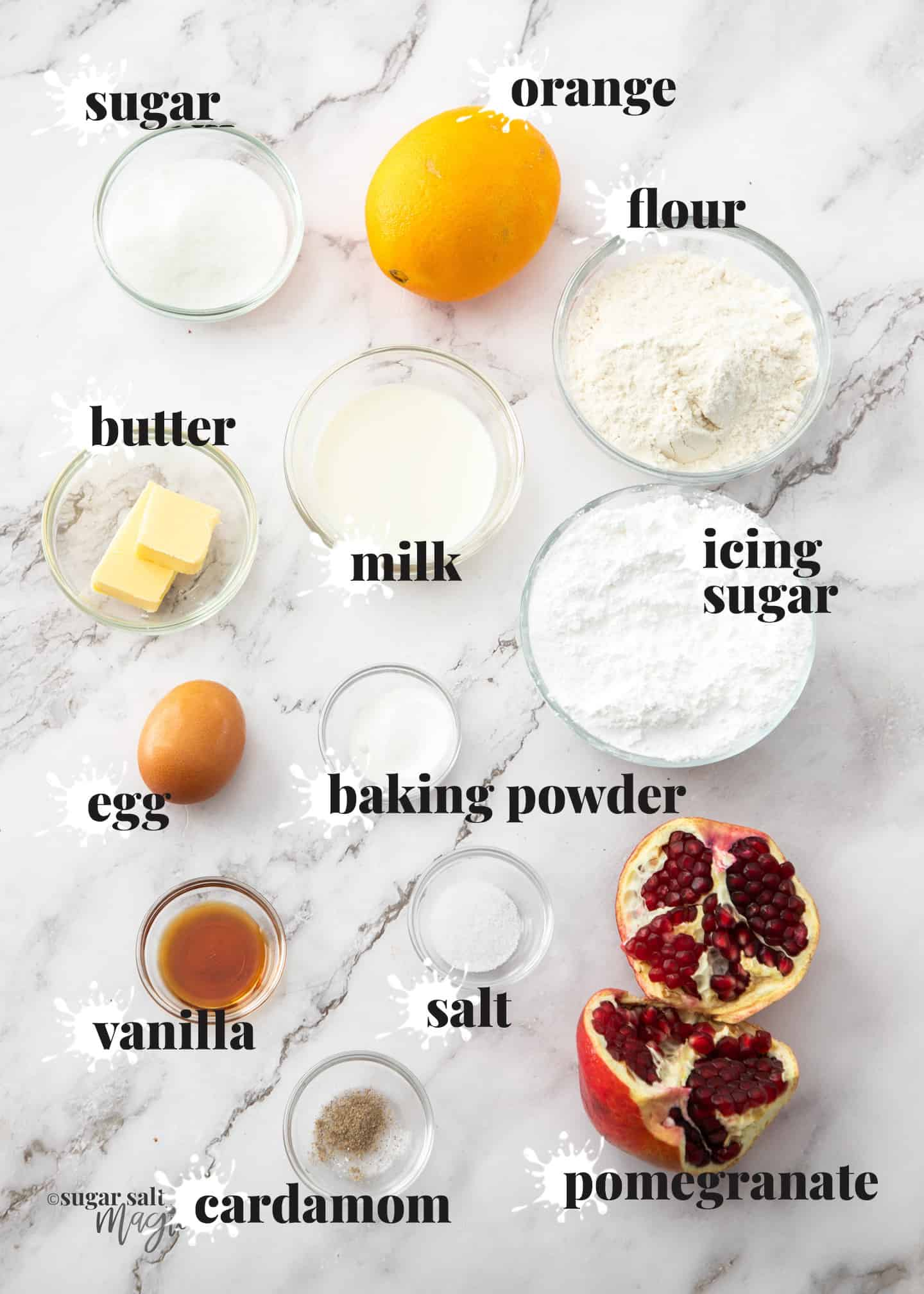 Ingredients for orange donuts on a marble benchtop.