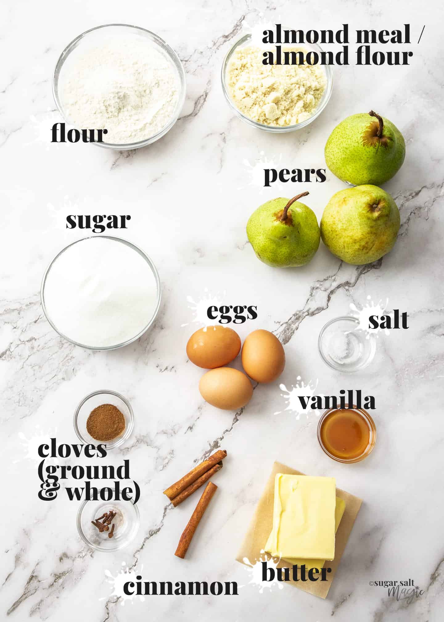 Ingredients for pear almond tarton a marble surface.