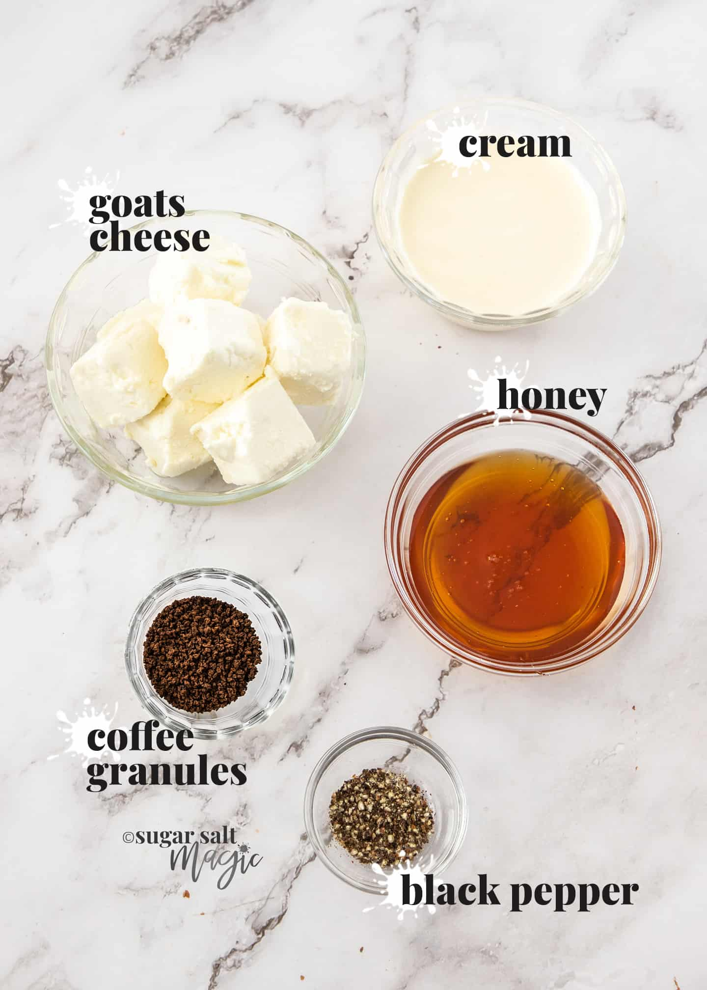 Ingredients for whipped goats cheese on a marble surface.