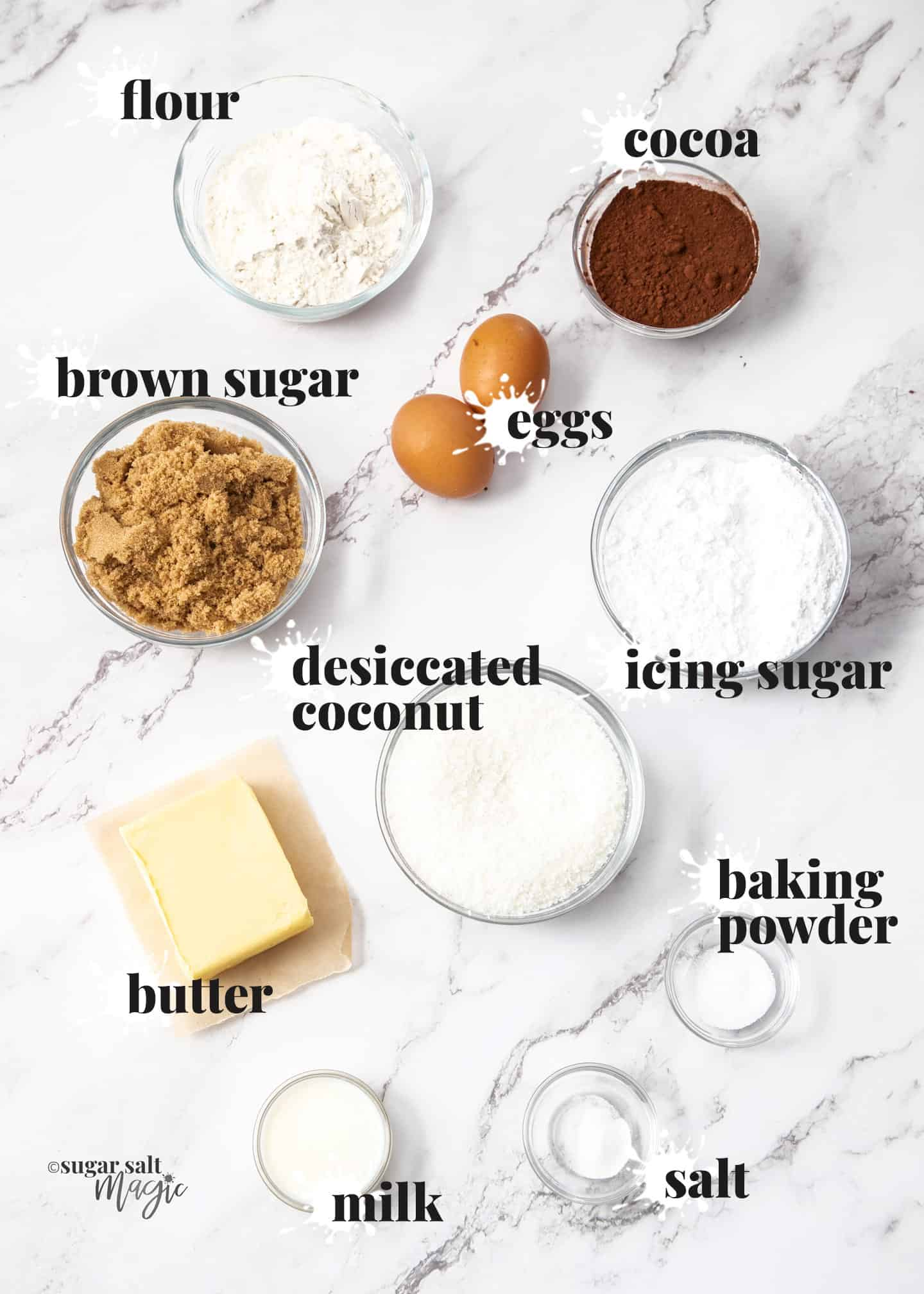 Ingredients for chocolate coconut slice on a marble surface.