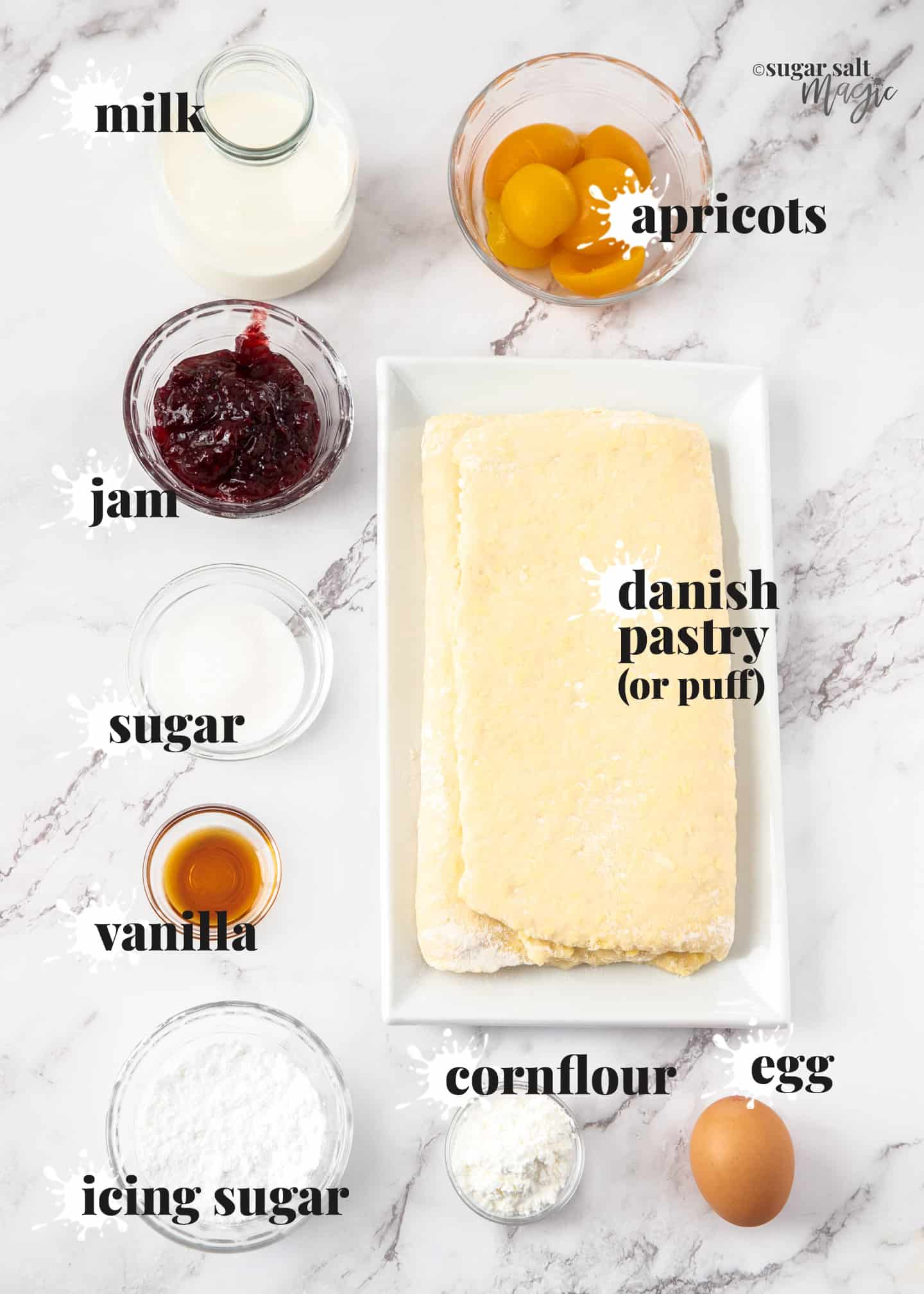 Ingredients for custard danish pastry on a marble surface.