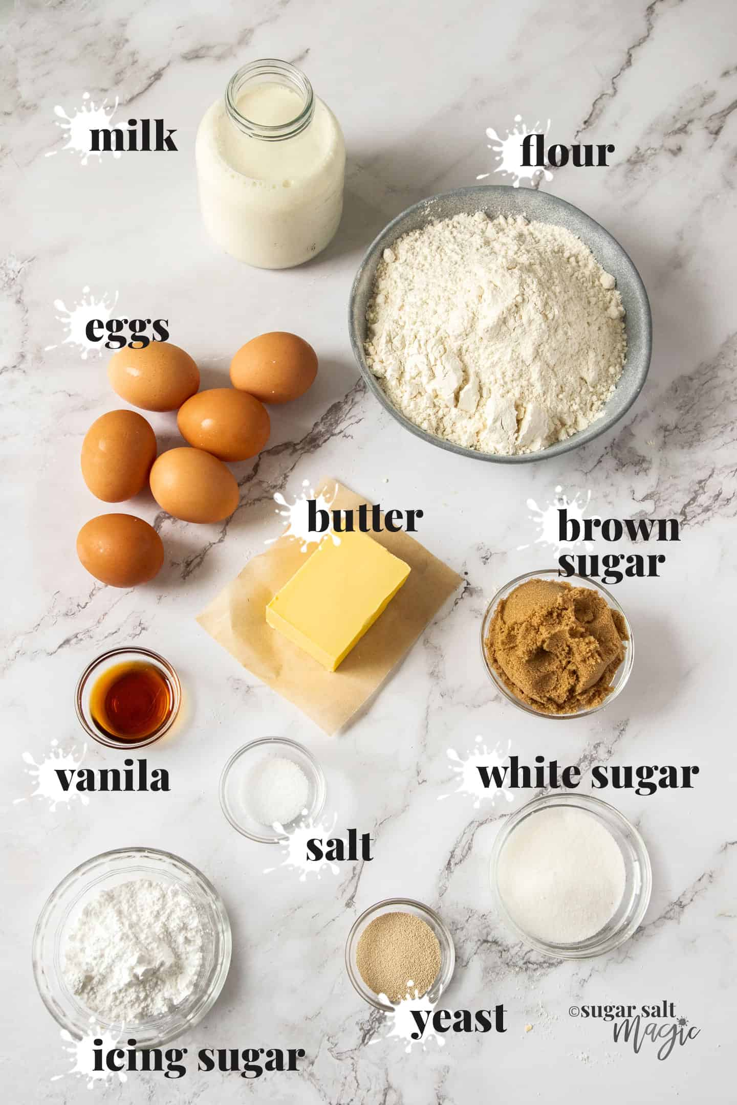 Ingredients for caramel doughnuts on a marble benchtop.