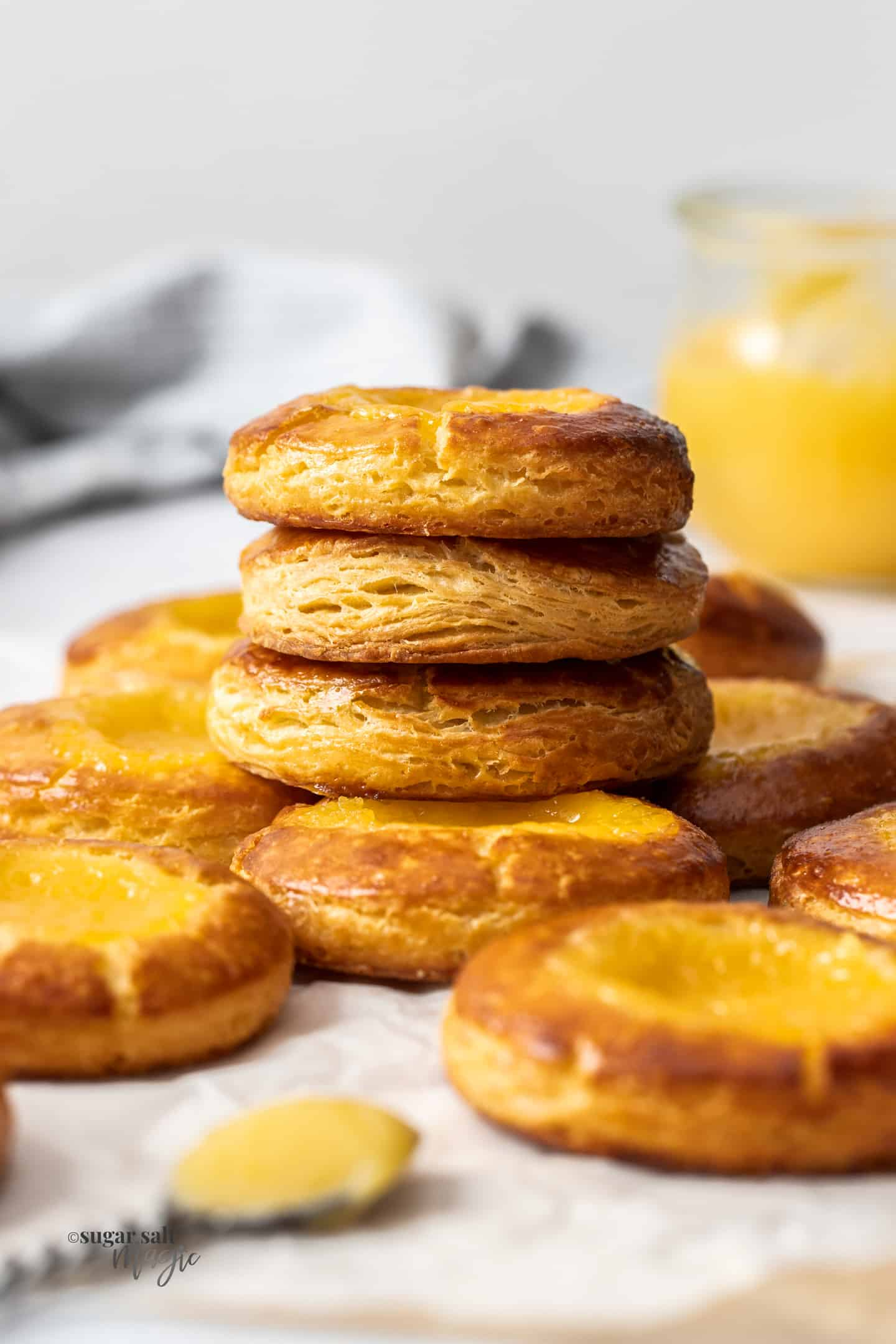 A stack of danish pastries filled with lemon curd.