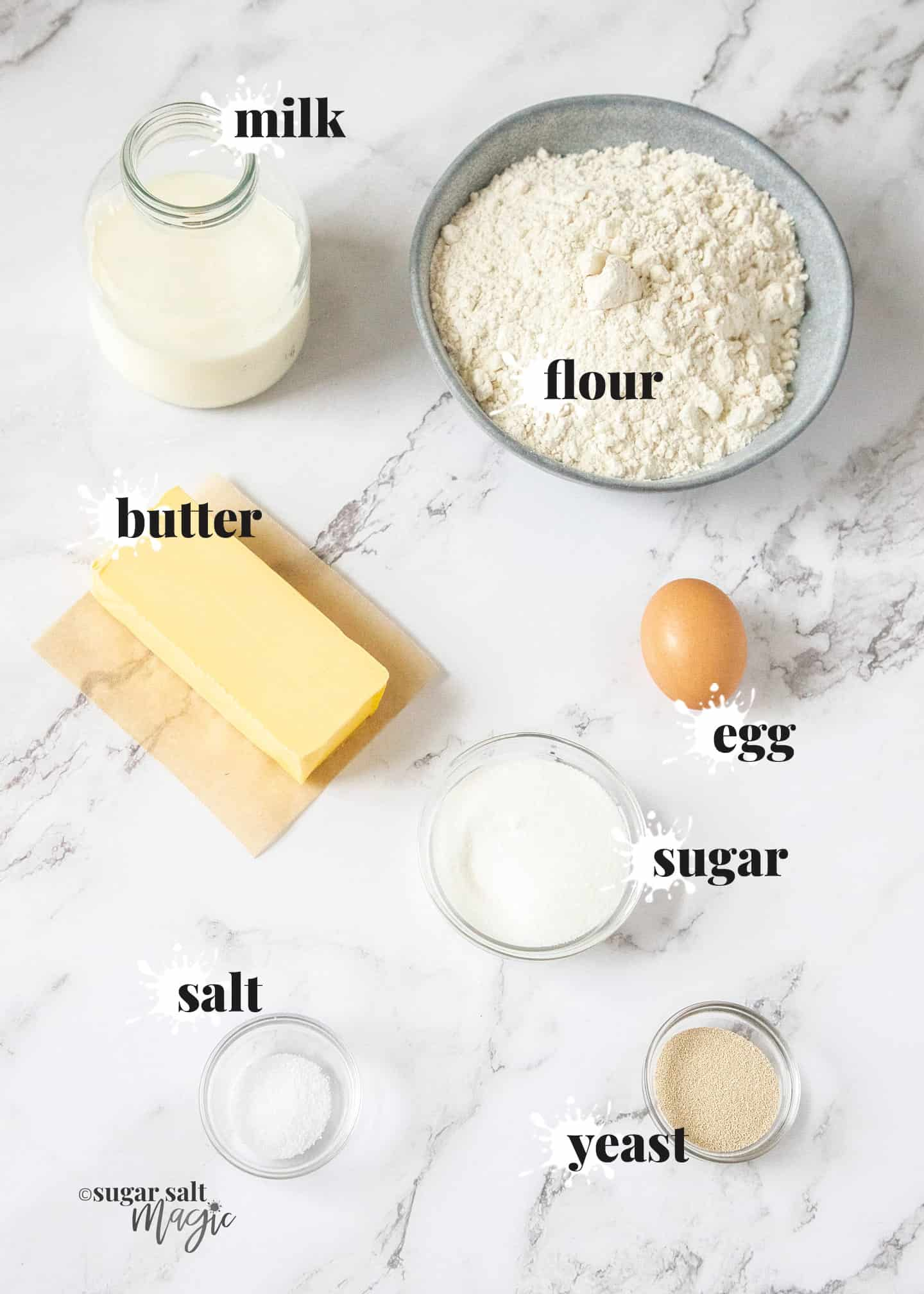 Ingredients for danish pastry dough on a marble countertop.
