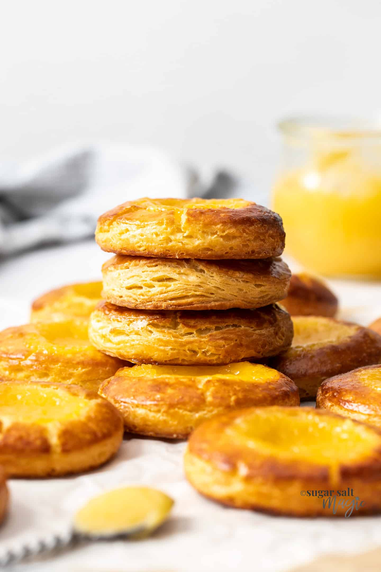 A stack of lemon curd pastries showing the layers on the sides.