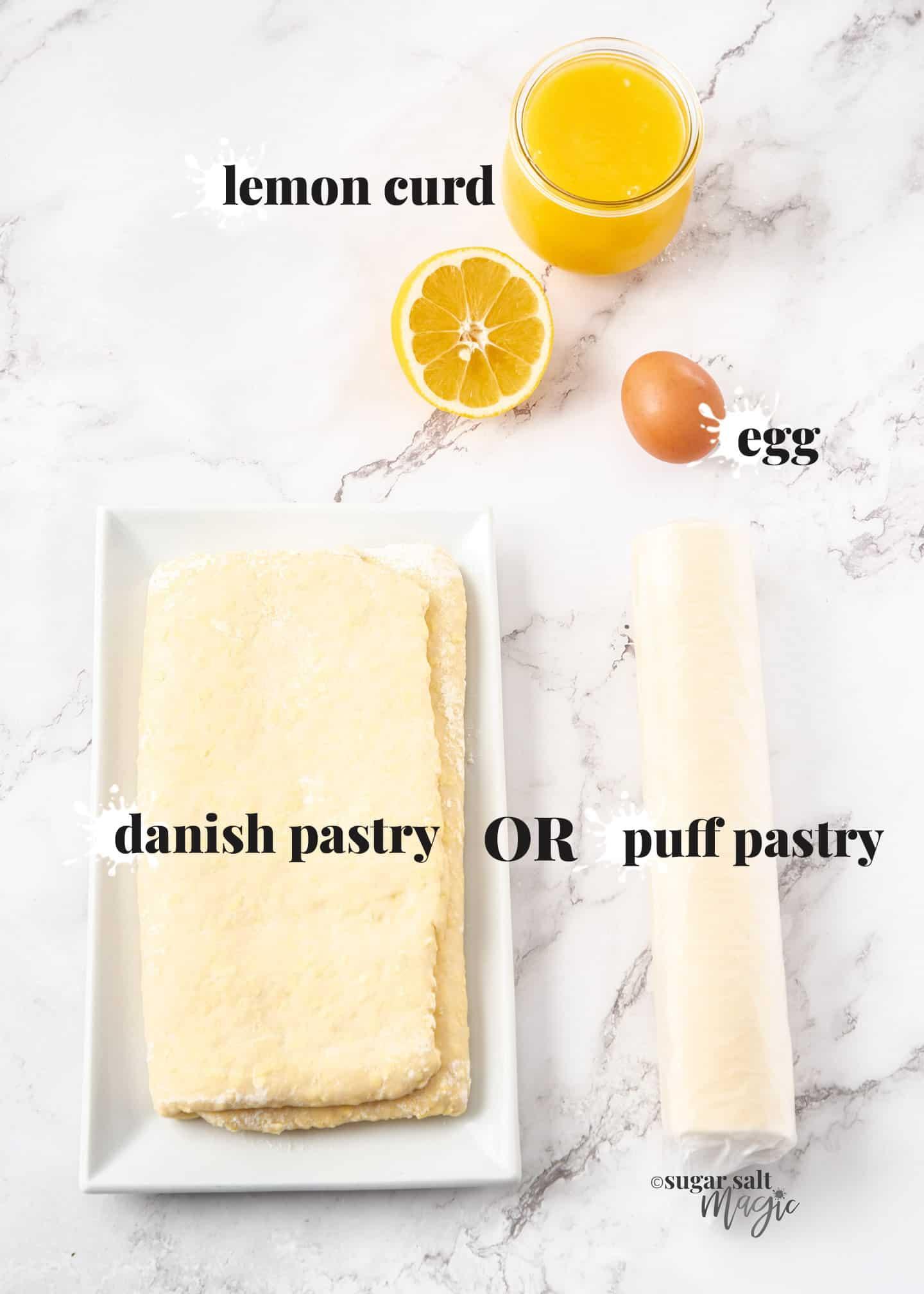 Ingredients for lemon pastry on a marble worktop.