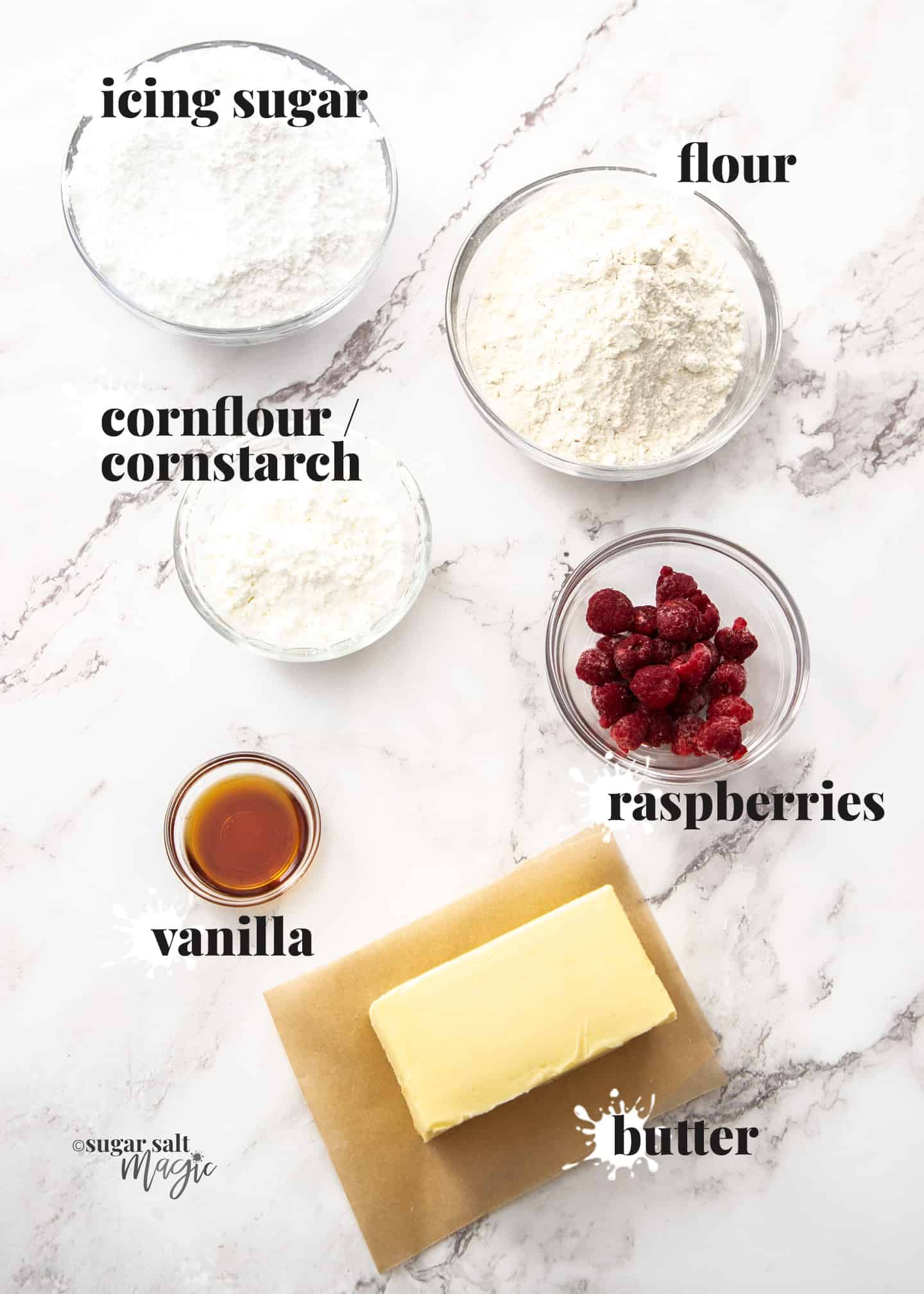 Ingredients for raspberry melting moments on a marble bench top.