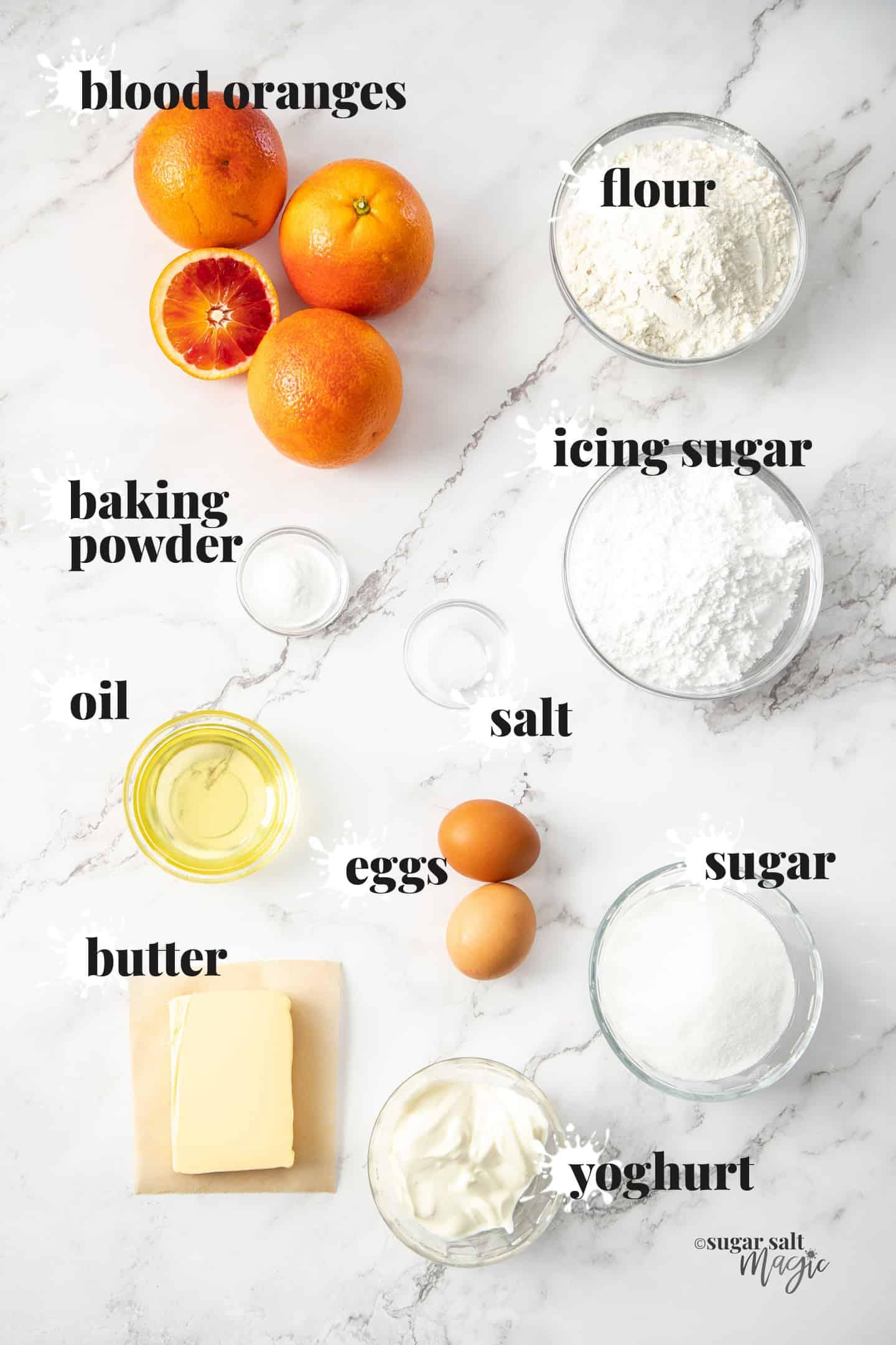 Ingredients for blood orange loaf cake on a marble benchtop.