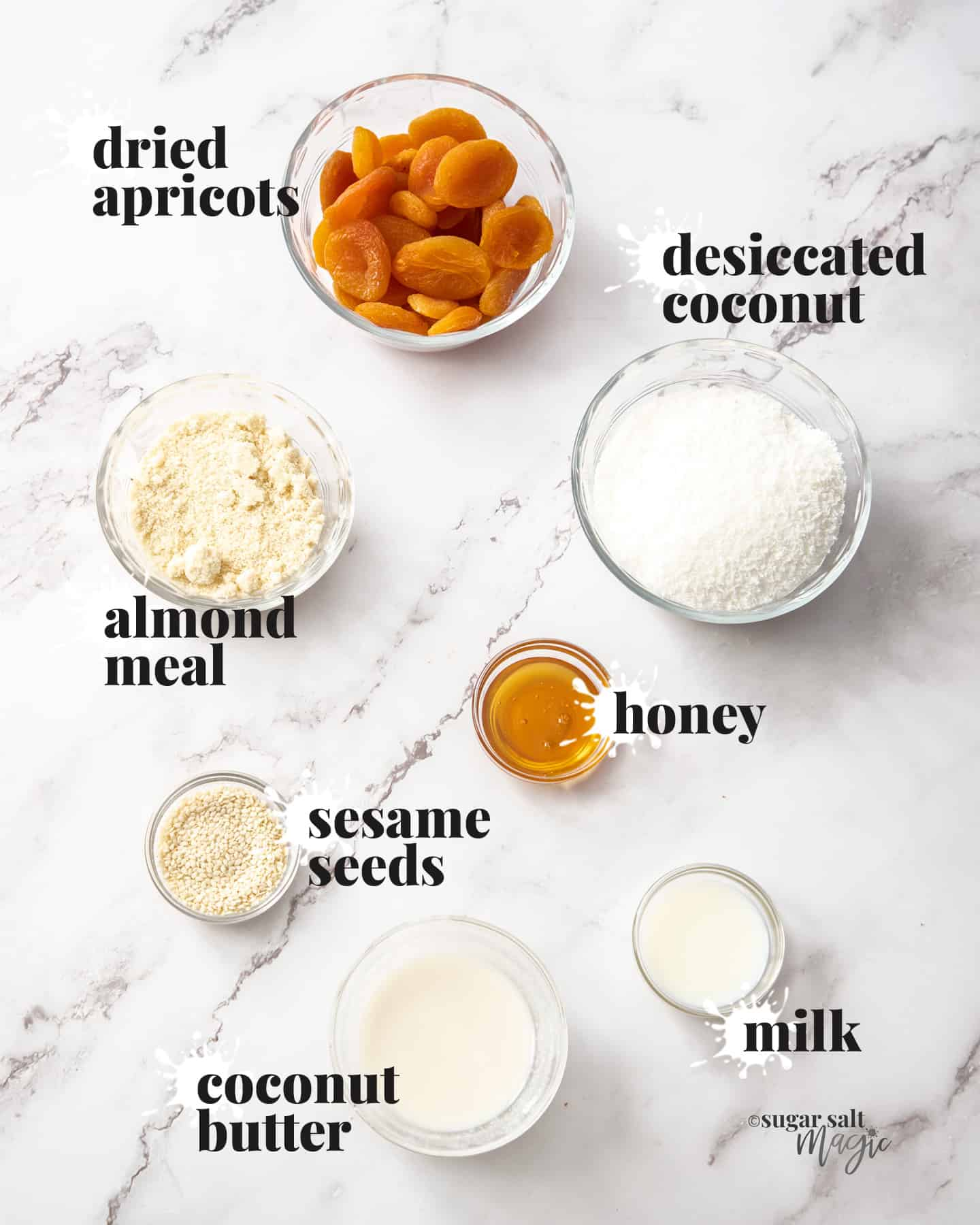 Ingredients for apricot bliss balls on a marble benchtop.