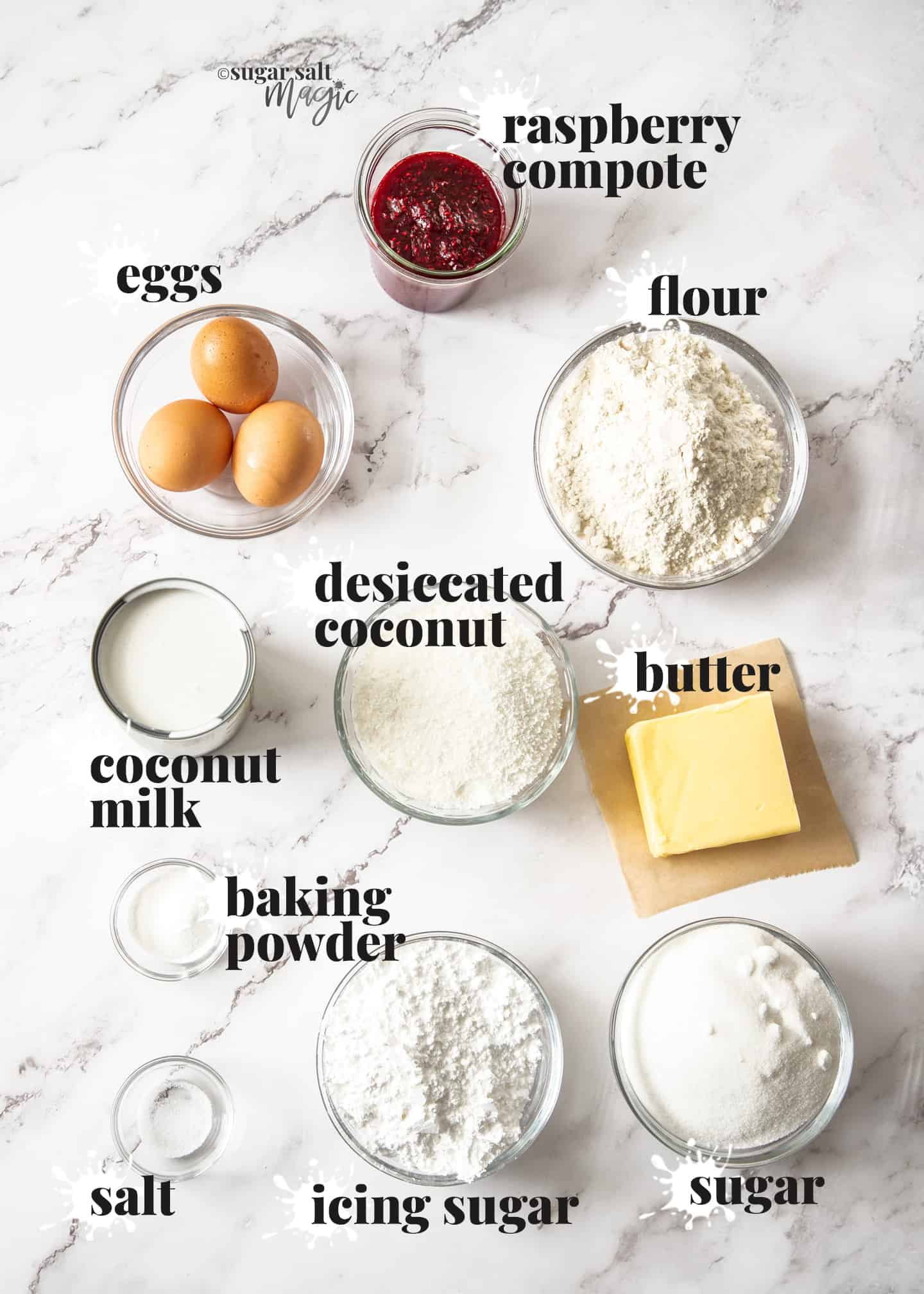 Ingredients for coconut raspberry loaf cake on a marble bench top.