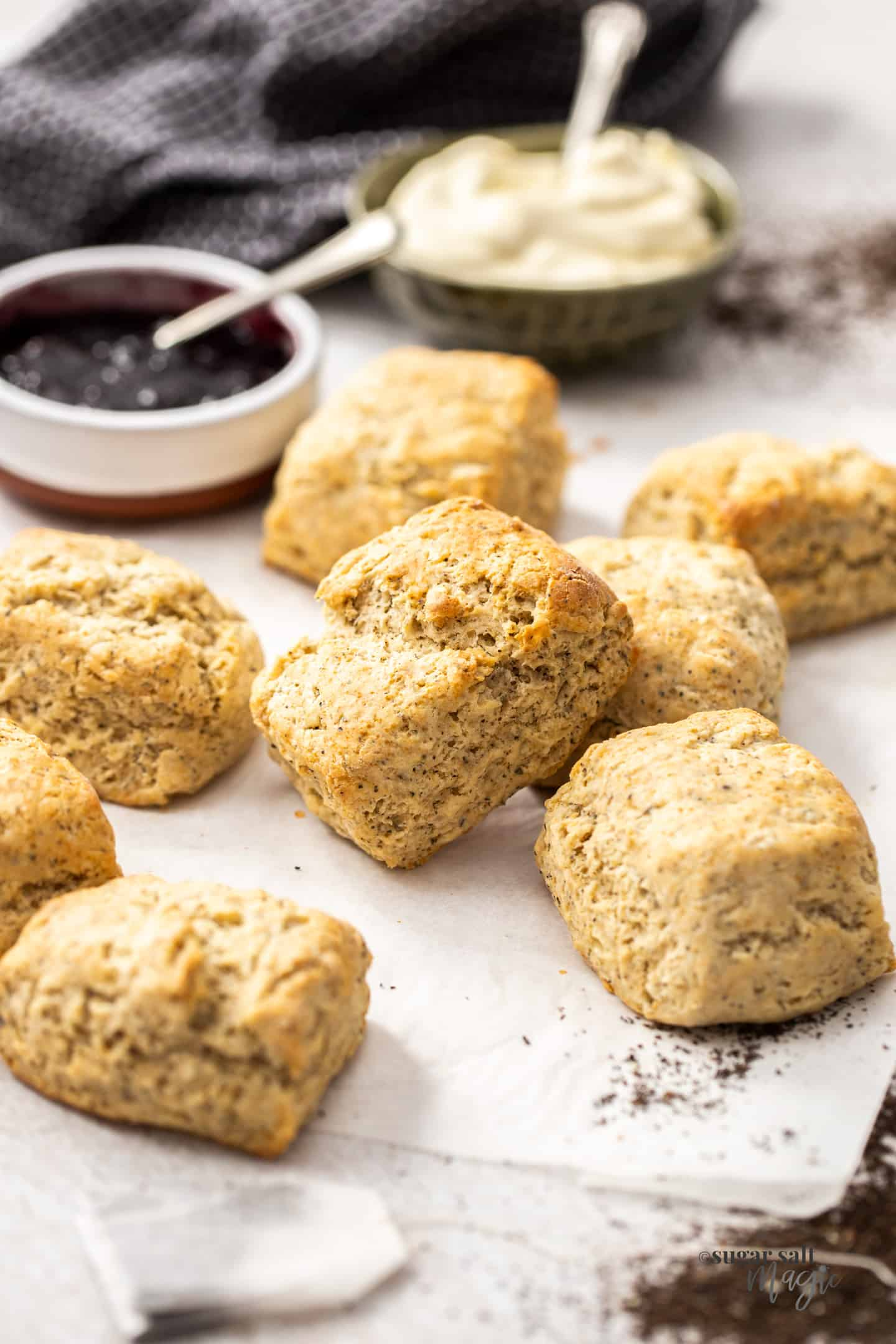 A batch of earl grey scones on a sheet of baking paper.