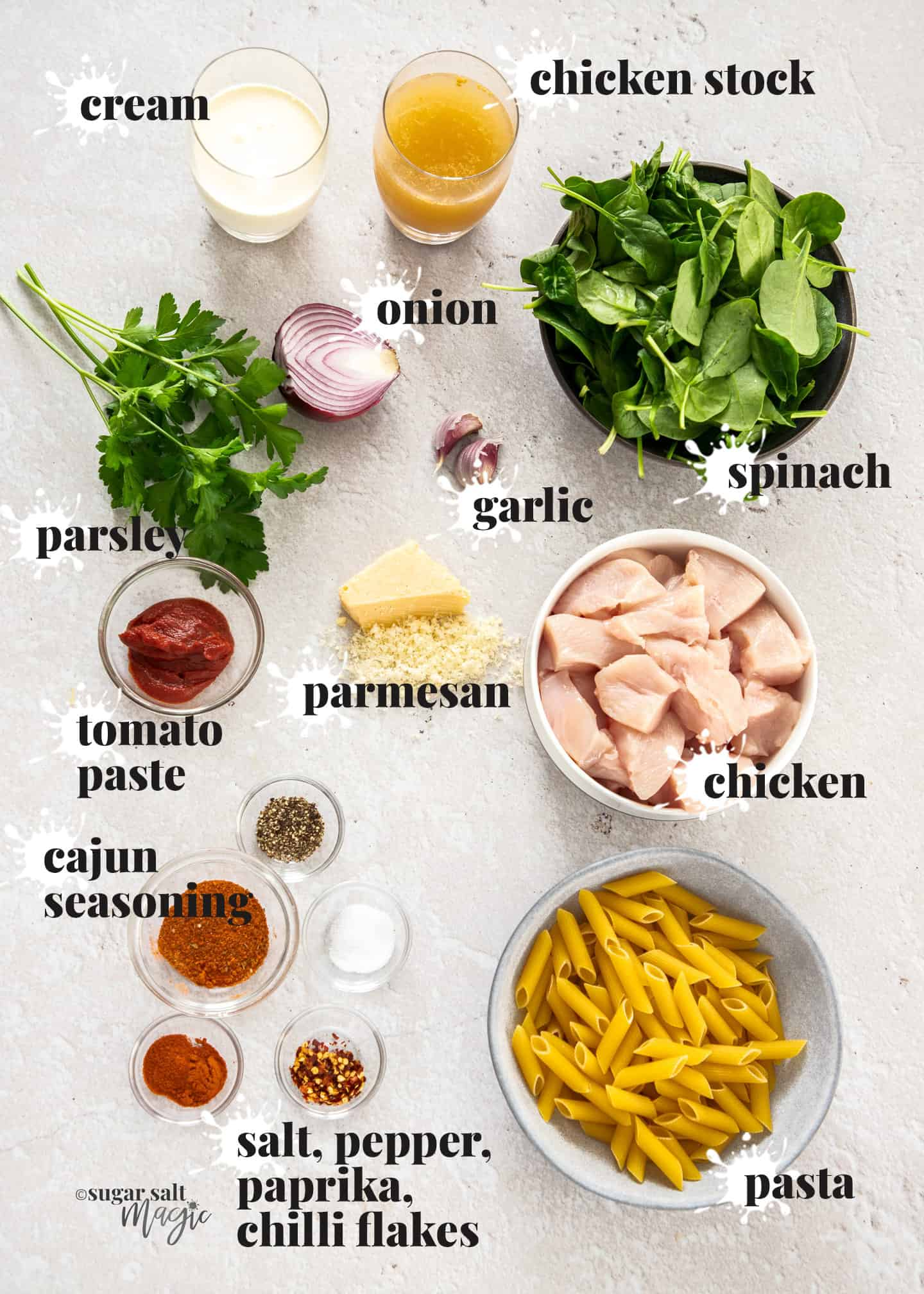 Ingredients for spicy chicken pasta on a stone benchtop.
