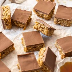 A batch of chocolate flapjacks on a sheet of baking paper.