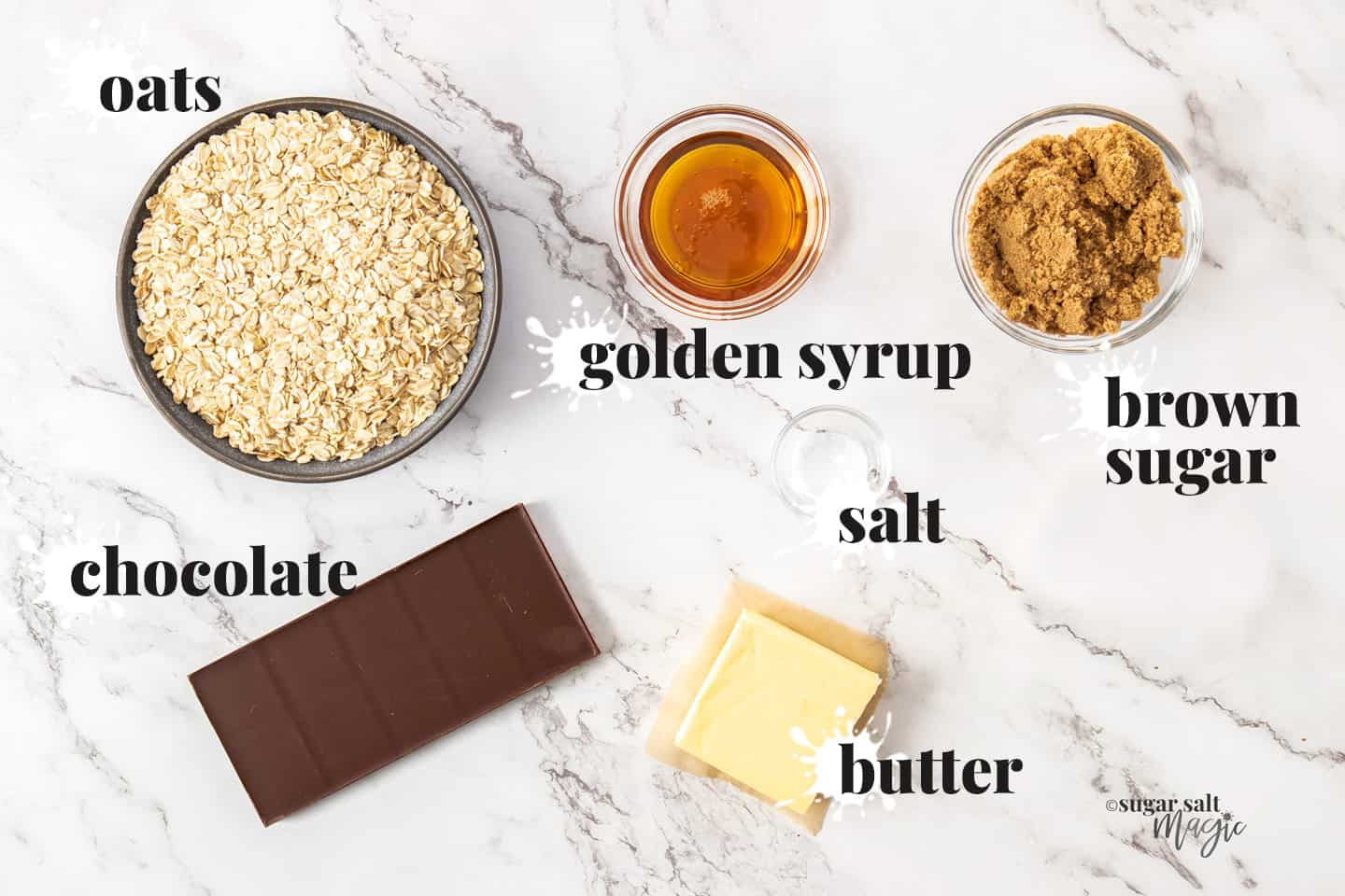 Ingredients for chocolate flapjacks on a marble work top.