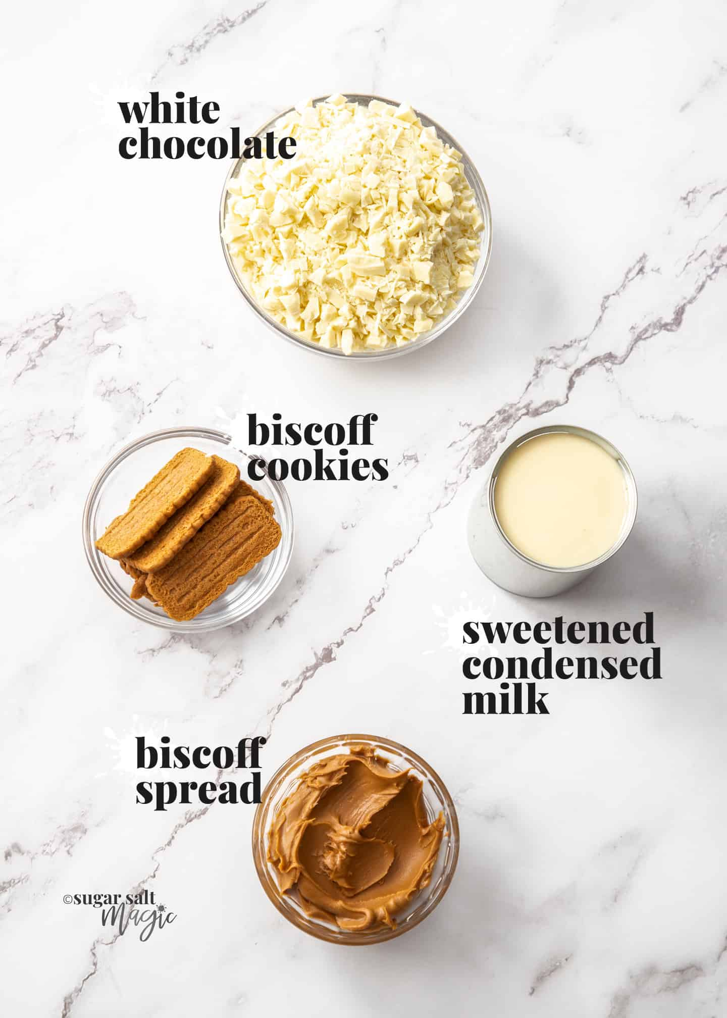 Ingredients for biscoff fudge on a marble benchtop.