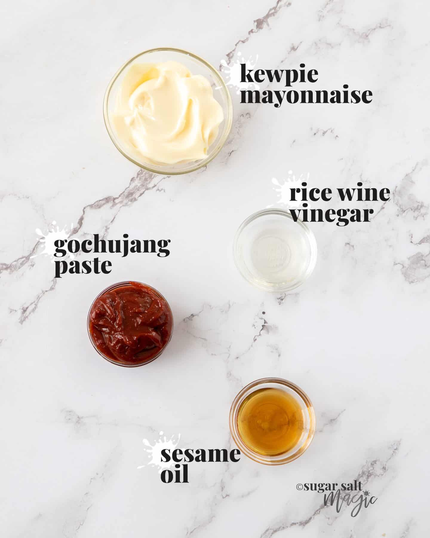 Ingredients for gochujang mayo on a white marble benchtop.