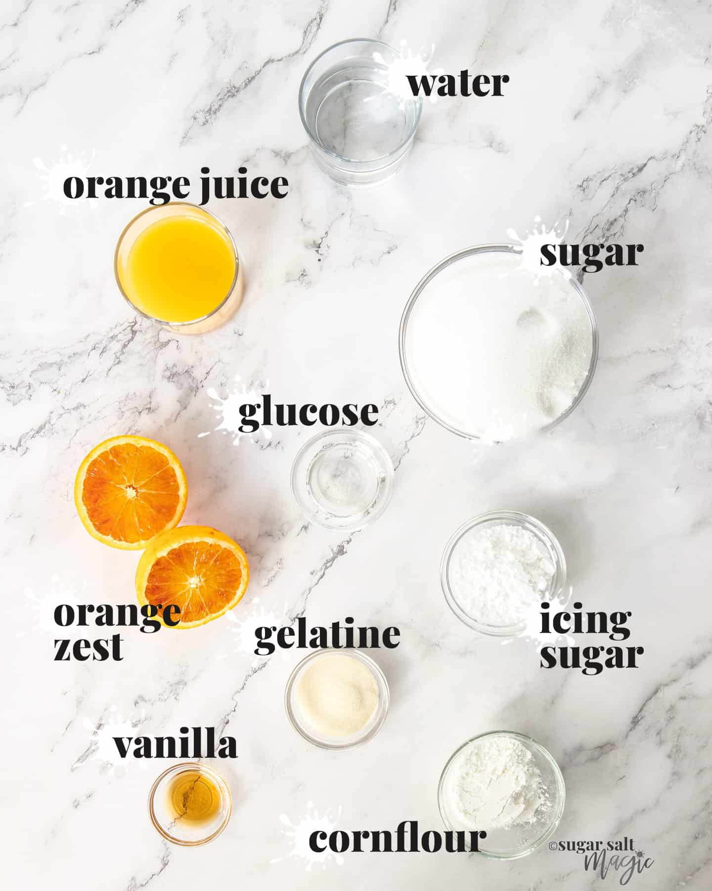 Ingredients for orange marshmallows on a marble benchtop.