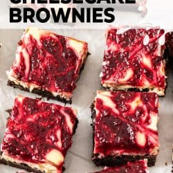 6 raspberry topped brownies on a sheet of baking paper.