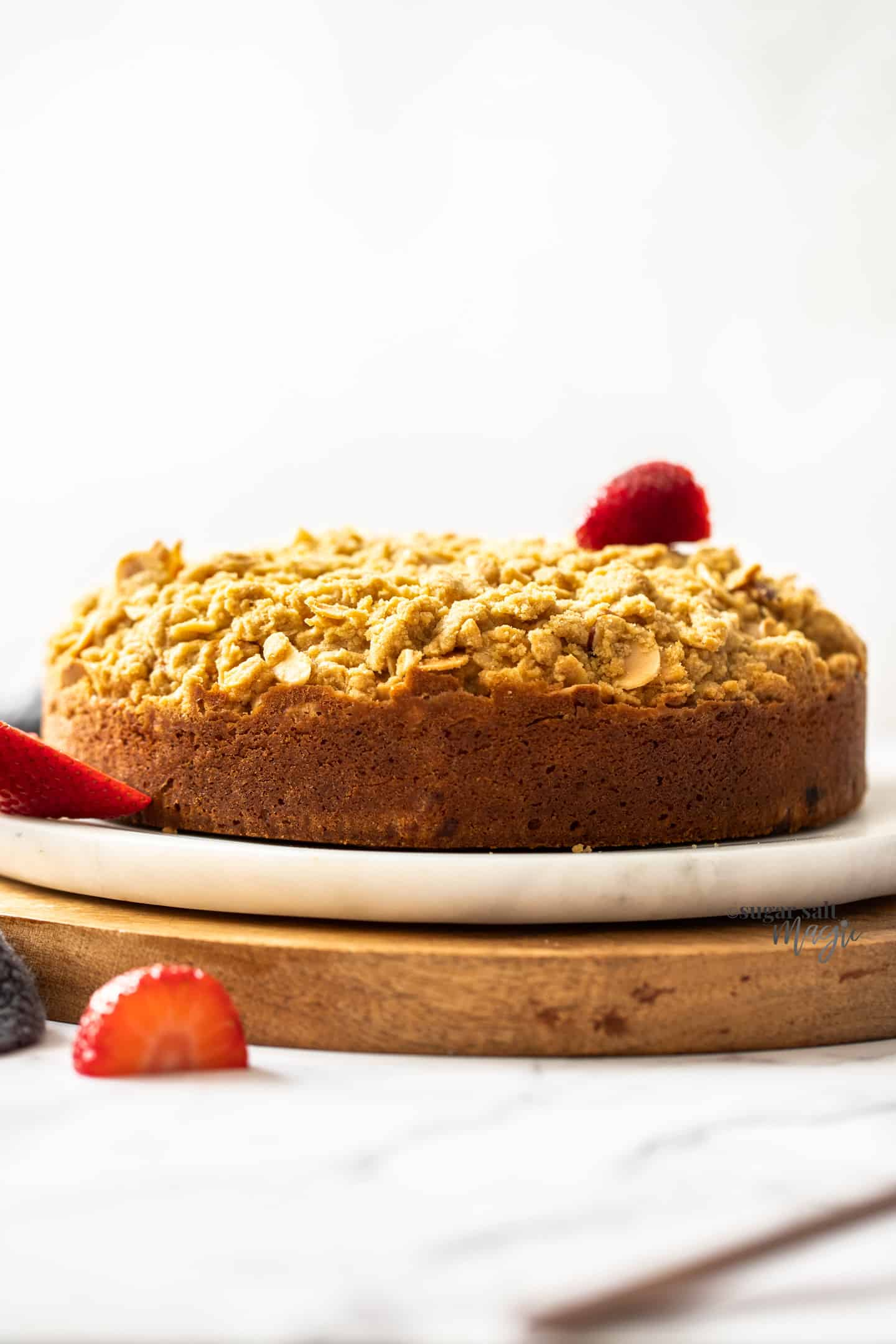 Side view of a cake with crumble topping