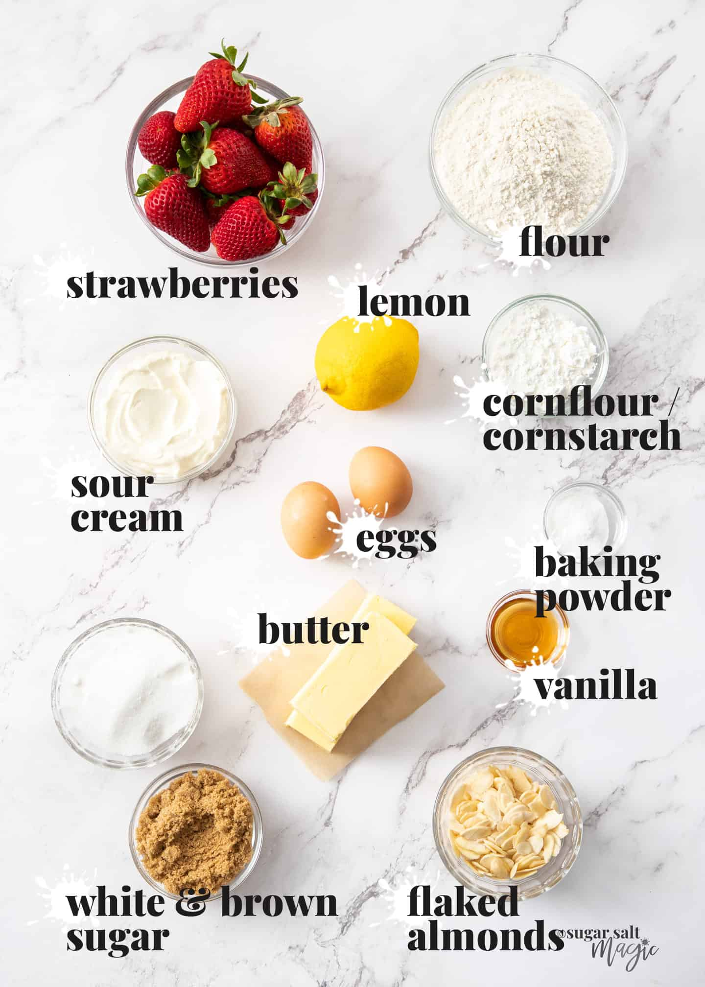 Ingredients for strawberry crumb cake on a white marble benchtop.