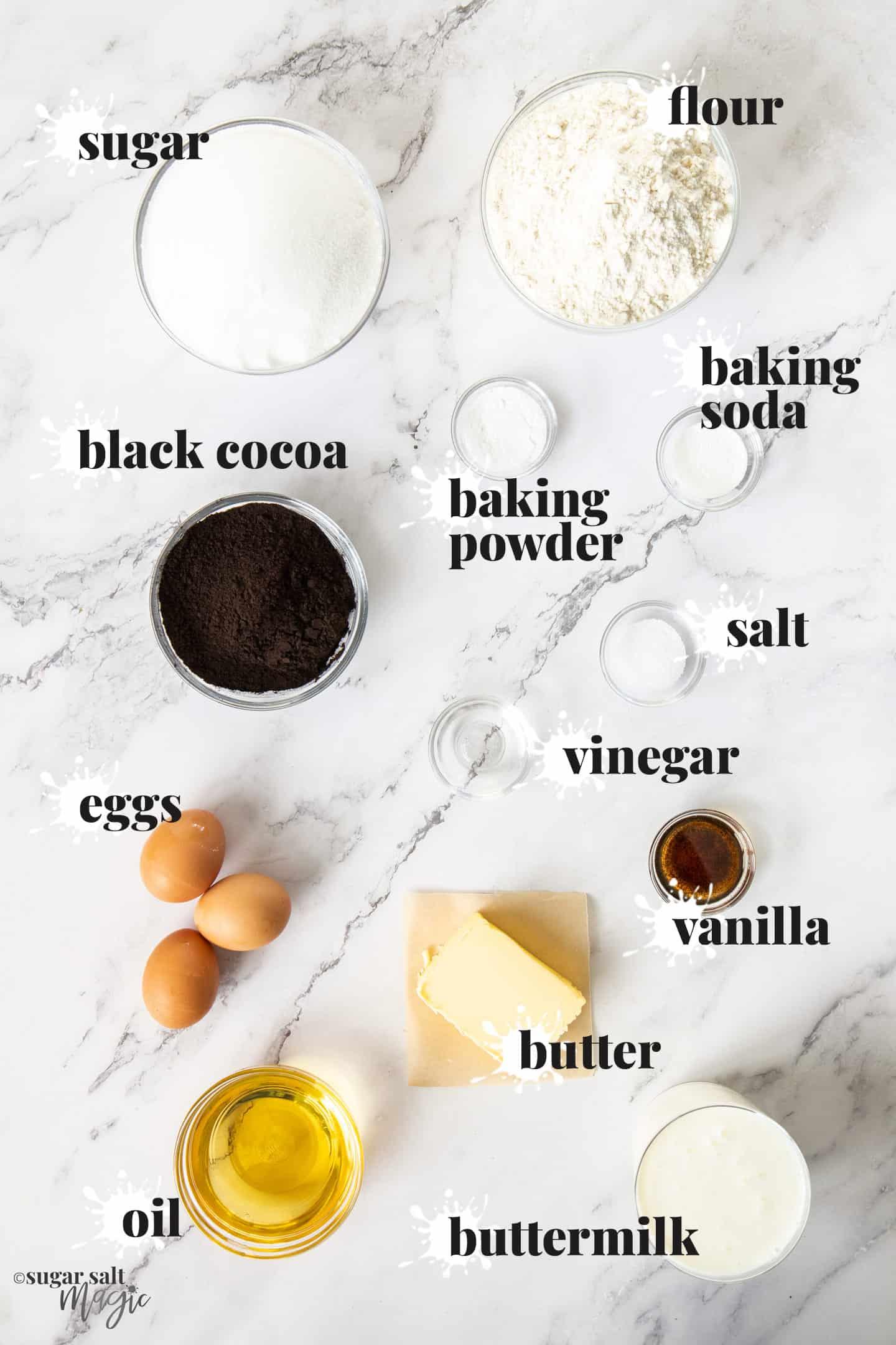 Ingredients for black velvet cake on a marble surface.